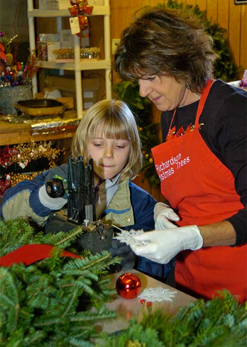 School field trips help students learn about agriculture as a business, seeing how Christmas trees are grown, cared for, harvested and sold, Winter School Field Trip to Richardson Adventure Christmas Tree Farm in Spring Grove, Illinois, NW of Chicago.