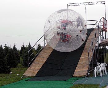 This giant ball is called an ORB, and you ORBit or ORB Ride down the slope at the corn maze and pumpkin patch at Richardson Adventure Farm, Spring Grove, Illinois, NW of Chicago in McHenry County.