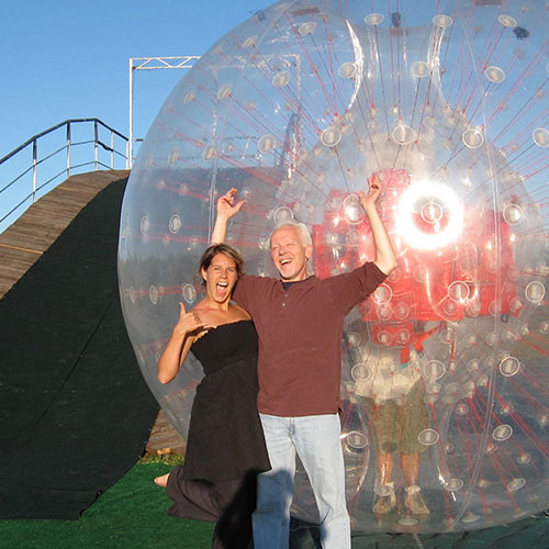 Ride down the hill in a giant ball with our Zorbing rides